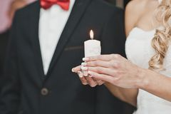 Burning candle in hands of the girl 2800. The bride holds a candle Stock Photography