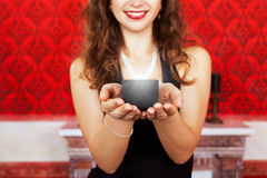 Burning candle in hands on red vintage background Royalty Free Stock Photo