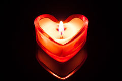 Burning candle heart Stock Photography