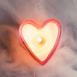 Burning candle heart Royalty Free Stock Photos