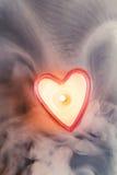 Burning candle heart Stock Photography