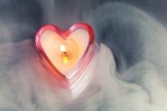 Burning candle heart Stock Image