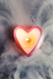 Burning candle heart Royalty Free Stock Images