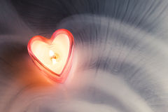 Burning candle heart Stock Images