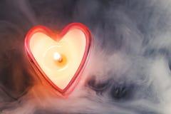 Burning candle heart Stock Photo