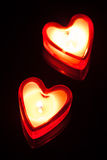 Burning candle hearts Stock Images