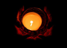 Burning candle in human hand Stock Photography