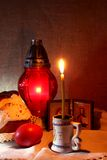 Burning candle and icons Royalty Free Stock Photo