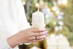 Free Burning Candle In The Hands Of A Girl. Christmas Candle. Christmas Decor. Woman`s Hands Holding Beautiful Candle With Fire. Copy Royalty Free Stock Photos - 160805998