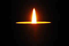 Burning candle isolated on black Stock Image