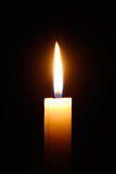 Burning candle isolated on black background Stock Photo