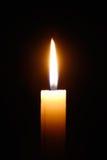 Burning candle isolated on black background. Closeup of burning candle isolated on black background Stock Photo