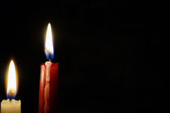 Burning candle isolated on black Stock Photos