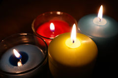 Burning candle isolated on black Stock Images