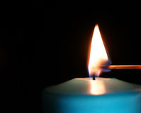 Burning candle isolated on black Royalty Free Stock Photography