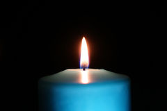 Burning candle isolated on black Stock Photography