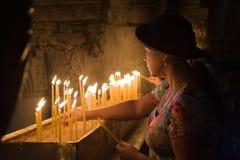 Burning a candle Stock Photo