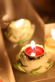 Burning Candle in lotus. Royalty Free Stock Images