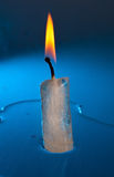 Burning candle made of ice Stock Image