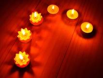 Burning candle in meditation Royalty Free Stock Photos
