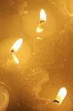 Burning candle. Melted candle. Reflection royalty free stock images