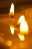 Burning candle. Melted candle. Reflection stock photography
