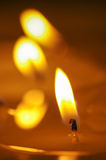 Burning candle. Melted candle. Reflection royalty free stock photography