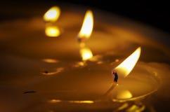 Burning candle. Melted candle. Reflection Stock Photo