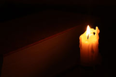 Burning candle near the book Royalty Free Stock Image