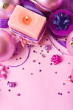 Burning candle and New Year's decor in violet Stock Image