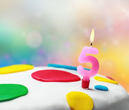 Burning candle with the number five Stock Image