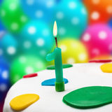 Burning candle with the number one Royalty Free Stock Photography
