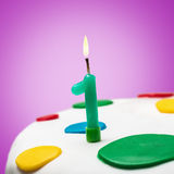 Burning candle with the number one Stock Photo
