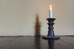 Burning candle in old candlestick Stock Photos
