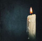 Burning candle over black Royalty Free Stock Photos
