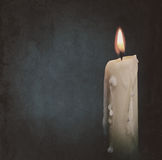 Burning candle over dark backgrounds. Abstract grungy still life Stock Image