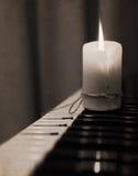 Burning candle, piano Royalty Free Stock Image