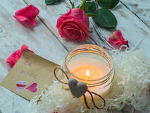 Burning candle and pink rose. love card. Valentine`s Day postcard. Royalty Free Stock Images