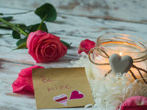 Burning candle and pink rose. love card. Valentine`s Day postcard. Stock Photo