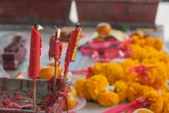 Burning candle in pot at chinese shrine. Stock Photography