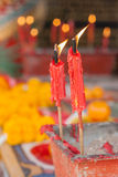 Burning candle in pot at chinese shrine. Stock Photos