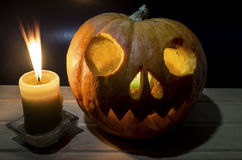 Burning candle with pumpkin head for Halloween Stock Photography