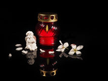 Burning candle in a red glass candlestick Stock Photography