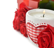 Burning candle and roses Royalty Free Stock Photos