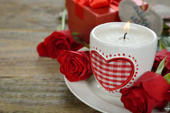Burning candle and roses Stock Image