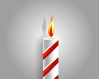Burning candle and shadow. On gray background Royalty Free Stock Photos