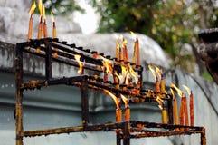 Burning candle on shelf Stock Image