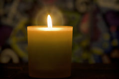 Burning candle. Single burning candle on colorful background Royalty Free Stock Image
