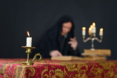 Burning candle in a small brass candlestick royalty free stock photos