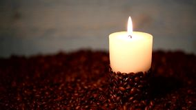 Burning candle surrounded stock video